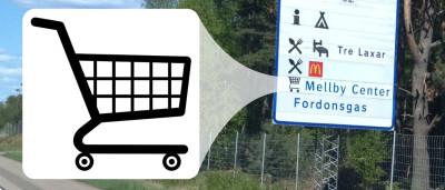 Senterskilt i Sverige med fremhevet handlevogn